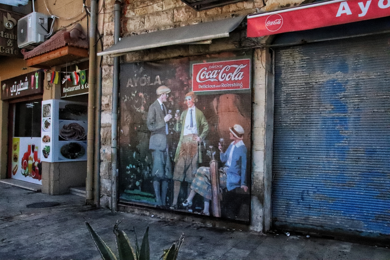 Jordanie - Promenade dans les rues de Madaba, vieille publicité Coca-Cola