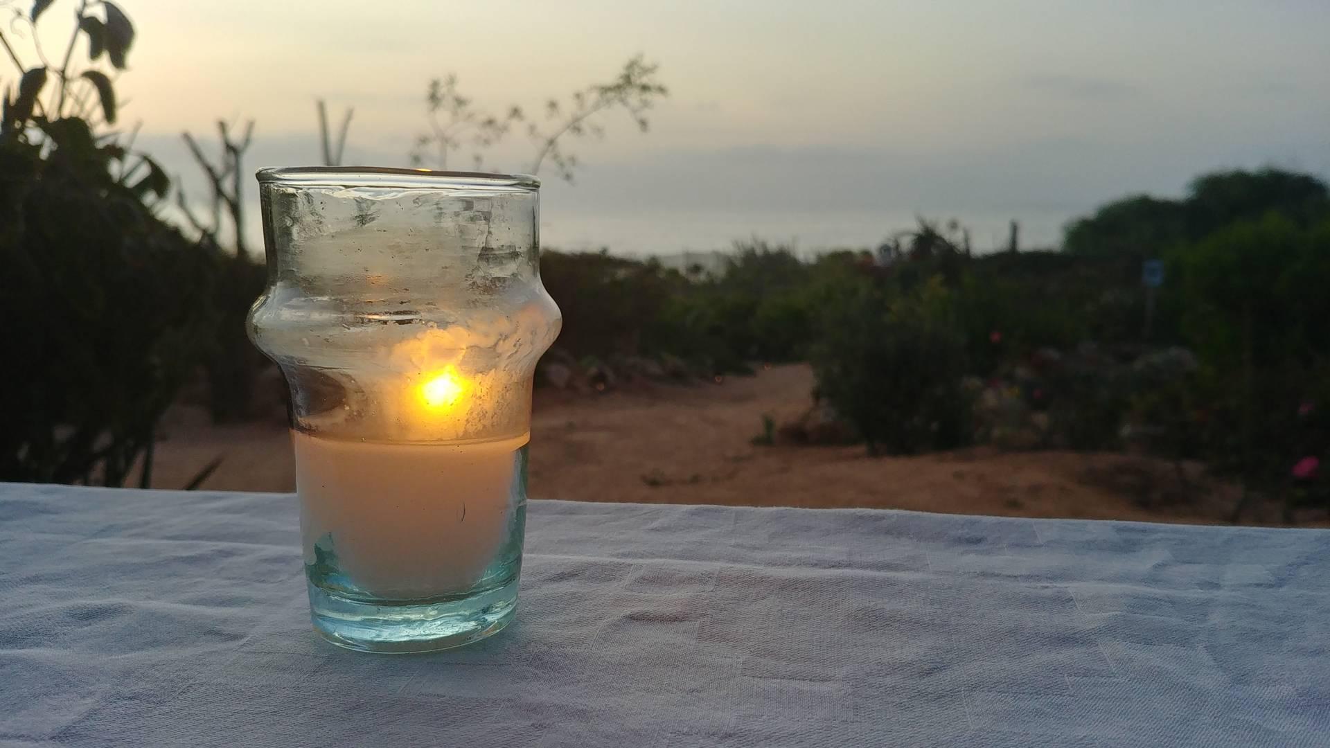 Maroc - Bougie au coucher de soleil sur l'Atlantique à Oualidia